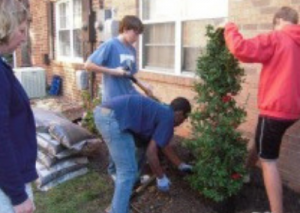 Boy Scouts from Troop 1865 help with landscaping