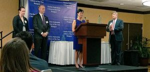 Candice Bennett, who nominated Cheryl Ellsworth for a Citation of Merit, and David Levine, President and CEO of Good Shepherd Housing & Family Services, watch as Cheryl thanks Fairfax Federation President Tim Thompson for her Citation of Merit