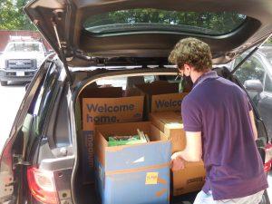 GSH Staff Member Brian Kelleher loads a car with books